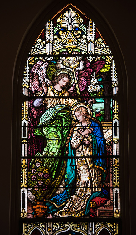 Stained glass window at St. Mary Church in Bear Creek, Wis., depicts the annunciation of Jesus' conception to Mary. (Sam Lucero photo)