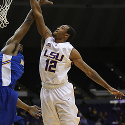 Jan 04, 2010; Baton Rouge, LA, USA; LSU Tigers guard Aaron Dotson (12) dunks over McNeese State Cowboys center Elbryan Neal (21) during the second half at the Pete Maravich Assembly Center.  Mandatory Credit: Derick E. Hingle-US PRESSWIRE