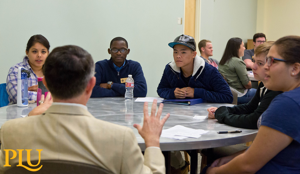 President Thom Krise and Joel Zylstra speak to a breakout group at the Student Leadership Institute at PLU on Monday, Aug. 31, 2015. (Photo: John Froschauer/PLU)