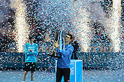Novak Djokovic lists the winning trophy during the final of the ATP World Tour Finals between Roger Federer of Switzerland and Novak Djokovic at the O2 Arena, London, United Kingdom on 22 November 2015. Photo by Phil Duncan.