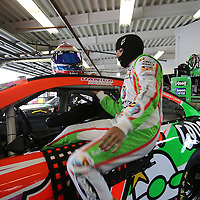 Driver Danica Patrick climbs into her race car during the first practice session of the 56th Annual NASCAR Coke Zero400 race at Daytona International Speedway on Thursday, July 3, 2014 in Daytona Beach, Florida.  (AP Photo/Alex Menendez)