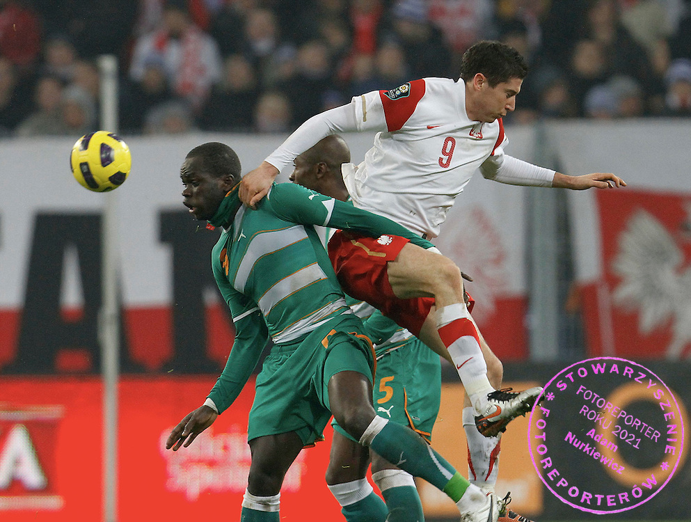 POLAND, Poznan : Cheick Tiote of Ivory Coast vies for the ball with Robert Lewandowski of Poland (R) during their international friendly football match in Poznan on November 17, 2010. Fot: / Piotr Hawalej/WROFOTO