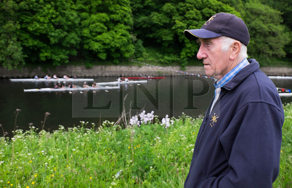 © Licensed to London News Pictures.13/06/15<br /> Durham, England<br /> <br /> A member of the team staff watches the racing during the 182nd Durham Regatta rowing event held on the River Wear. The origins of the regatta date back  to commemorations marking victory at the Battle of Waterloo in 1815. This is the second oldest event of this type in the country and attracts over 2000 competitors from across the country.<br /> <br /> Photo credit : Ian Forsyth/LNP