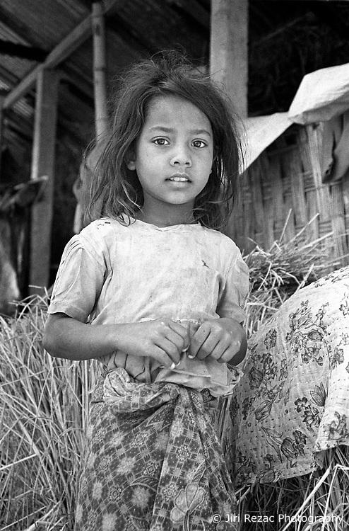 BANGLADESH DINAJPUR DISTRICT KAHAROL THANA JAN95 - A young Hindu girl poses for a photo outside her bari in rural Dinajpur...jre/Photo by Jiri Rezac..© Jiri Rezac 1994
