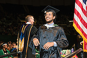 Miguel Franco reacts after receiving his masters degree at graduate commencement. Photo by Ben Siegel
