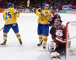 15.05.2012, Ericsson Globe, Stockholm, SWE, IIHF, Eishockey WM, Schweden (SWE) vs Lettland (LVL), im Bild Sverige Sweden 32 Marcus Kruger, Sverige Sweden 25 Viktor Stalberg Stålberg, Latvia 1 Goalkeeper Maris Jucers (Dinamo Riga) // during the IIHF Icehockey World Championship Game between Schweden (SWE) vs Latvia (LVL) at the Ericsson Globe, Stockholm, Sweden on 2012/05/15. EXPA Pictures © 2012, PhotoCredit: EXPA/ PicAgency Skycam..***** ATTENTION - OUT OF SWE *****