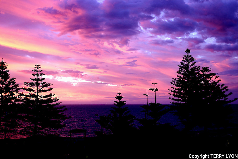 A beautiful evening pink sky sunset taken from my apartment over Beaches Cafe Cottesloe Beach.