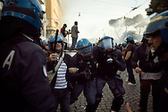 ITALY, Rome, October 15, 2011: A police officer is dragged away by colleagues during clashes in Rome, Saturday, Oct. 15, 2011.  © Christian Minelli/Emblema.