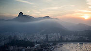 The sun sets ofver Rio de Janeiro as mist rolls in from the sea. Scenes from Rio de Janeiro on the day that Brazil drew 0-0 with Mexico. Photo by Andrew Tobin/Tobinators Ltd