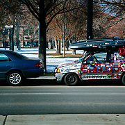 A parked dilapidated car in downtown Salt Lake City, Utah.