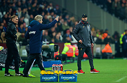 LONDON, ENGLAND - Monday, February 4, 2019: Liverpool's manager Jürgen Klopp looks at West Ham United's manager Manuel Pellegrini during the FA Premier League match between West Ham United FC and Liverpool FC at the London Stadium. (Pic by David Rawcliffe/Propaganda)