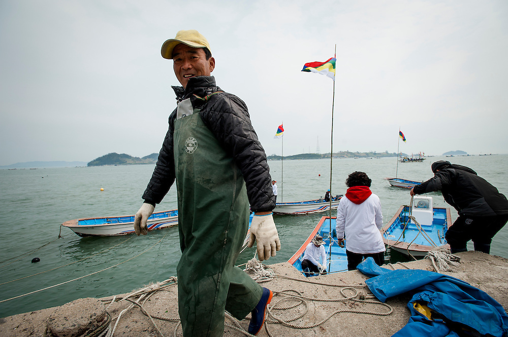 """Thousands of people came to Jindo, South Korea, to see the Jindo """"Miracle"""" Sea Festival. Once a year, a 2.8km landbridge is exposed due to low tides. People cross the landbridge from Jindo to a neighboring islet."""