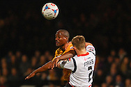Tom Elliott of Cambridge United wins the aerial battle with Fraser Franks of Luton Town during the Skrill Conference Premier match at the Abbey Stadium, Cambridge<br /> Picture by David Horn/Focus Images Ltd +44 7545 970036<br /> 11/03/2014