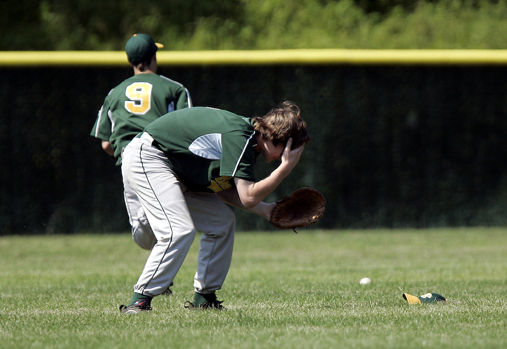 Brewster's Shane DeWitt reacts after missing a fly ball while centerfielder Korey Keefe chases the ball during the Little League Juniors Baseball State Final Four between Brewster and Suffern at Fox Valley Park in Lewisboro July 26, 2008.  Suffern won the game 8-5. ( Mike Roy / The Journal News )