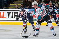 KELOWNA, CANADA - MARCH 4: Keltie Jeri-Leon #27 of the Tri-City Americans stick checks Kole Lind #16 of the Kelowna Rockets during first period on March 4, 2017 at Prospera Place in Kelowna, British Columbia, Canada.  (Photo by Marissa Baecker/Shoot the Breeze)  *** Local Caption ***