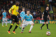 Watford midfielder Abdoulaye Doucoure (16) and Burton Albion midfielder Will Miller (18) during the The FA Cup 3rd round match between Watford and Burton Albion at Vicarage Road, Watford, England on 7 January 2017. Photo by Richard Holmes.