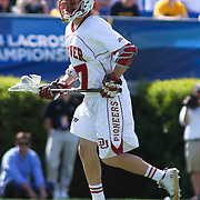 Denver Midfielder Colin Woolford (57) seen in the second half of The NCAA Division I Men's Lacrosse Tournament game between the No. 5 seed Denver and No. 12 ranked Drexel Sunday, May. 18, 2014 at Delaware Stadium in Newark, DEL