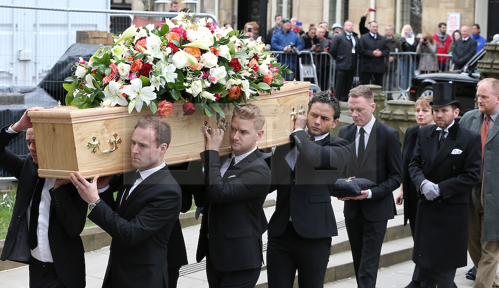 © Licensed to London News Pictures . 18/03/2016 . Manchester , UK . L to R Jack P. Shepherd, Alan Halsall, Mikey North and Ryan Thomas carrying the coffin, followed by Antony Cotton carrying Tony Warren's mbe. Television stars and members of the public attend the funeral of Coronation Street creator Tony Warren at Manchester Cathedral . Photo credit : Joel Goodman/LNP