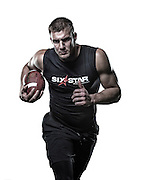 Rob Gronkowski in White by Reggie Ferraz, sports commercial and advertising photographer.