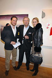 Left to right, SIMON LIEBEL, BRODERICK MUNRO-WILSON and his daughter EMMA MUNRO-WILSON at a private view of artist Hsiao-Mei Lin's paintings held at the Adam gallery, 24 Cork Street, London on 28th April 2008.<br />