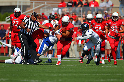 17 September 2016:  Umpire Scott Jones scrambles to get out of the way as DeMarco Corbin cuts upfield and Bradley Dewberry looks to end the advance. NCAA FCS Football game between Eastern Illinois Panthers and Illinois State Redbirds for the 105th Mid-America Classic on Family Dat at Hancock Stadium in Normal IL (Photo by Alan Look)