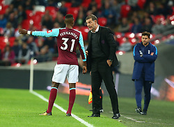 October 25, 2017 - London, England, United Kingdom - West Ham United manager Slaven Bilic  haveng words with West Ham United's Edimilson Fernandes.during Carabao Cup 4th Round match between Tottenham Hotspur and West Ham United at Wembley Stadium, London,  England on 25 Oct  2017. (Credit Image: © Kieran Galvin/NurPhoto via ZUMA Press)
