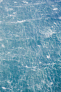 An aerial over wind-crested waves along the ocean surface, New Zealand