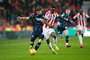 Leeds United midfielder Mateusz Klich (43)  goes past Stoke City midfielder Oghenekaro Etebo (8)  during the EFL Sky Bet Championship match between Stoke City and Leeds United at the Bet365 Stadium, Stoke-on-Trent, England on 19 January 2019.
