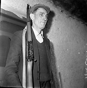 """Lead Mines at Loughrea..1962..08.01.1962..01.08.1962..8th January 1962..Prospecting started in Loughrea in what is thought to be lead deposits beneath the lands of several small farms in the area...Image shows """"The Big Man"""" standing guard at the drilling operation in Loughrea."""