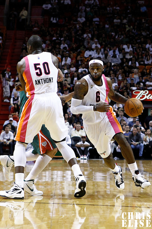 22 January 2012: Miami Heat small forward LeBron James (6) drives to the basket on a screen set by Miami Heat center Joel Anthony (50) during the Milwaukee Bucks 91-82 victory over the Miami Heat at the AmericanAirlines Arena, Miami, Florida, USA.