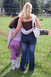 Mother and daughter on a children's outing to a working farm,