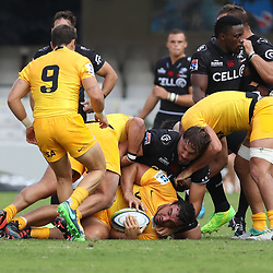 Etienne Oosthuizen of the Cell C Sharks tackling Agustin Creevy (captain) of the Jaguares during the Super Rugby match between the Cell C Sharks and the Jaguares  April 8th 2017 - at Growthpoint Kings Park,Durban South Africa Photo by (Steve Haag)