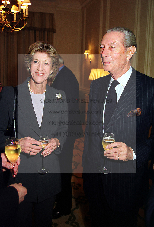 COMTE & COMTESSE FREDERIC CHANDON de BRIAILLES head of the Moet & Chandon Champagne house, at a luncheon in London on 8th December 1999.<br /> MZW 15