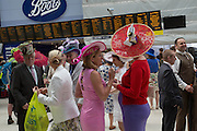 WEARING  FISHHEAD HAT BY ANDREW FISH, Royal Ascot racegoers at Waterloo station. London. 19 June 2013.