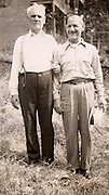 wo elderly man posing for photograph