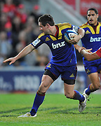 Mike Delany steps inside the tackle of Mike Harris (unseen) during the Super 15 Rugby (Round 17) fixture between the Queensland Reds and the Otago Highlanders played at Suncorp Stadium (Brisbane) on Friday 6th July 2012 ~ Reds (19) defeated the Highlanders (13) ~ Editorial Use only in accordance with QRU Terms & Conditions ~ Photo Credit Required : Steven Hight (AURA Images/Photosport NZ)