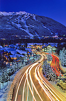 A time exposure of the cars driving Lorimer Road, from Blackcomb Mountain in Whistler, BC winter twilight.