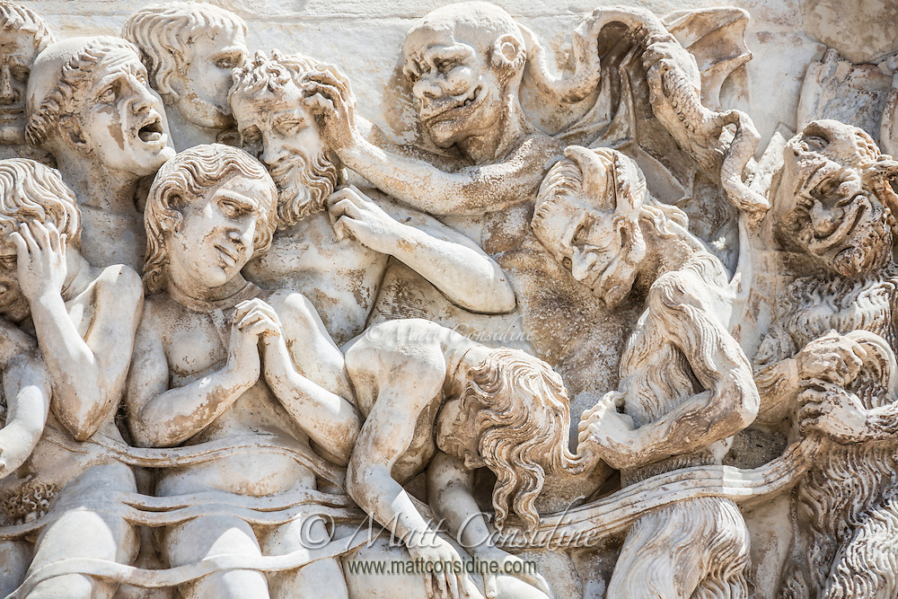 Gruesome sculpture on the facade of the Orvieto cathedral. (Photo by Travel Photographer Matt Considine)
