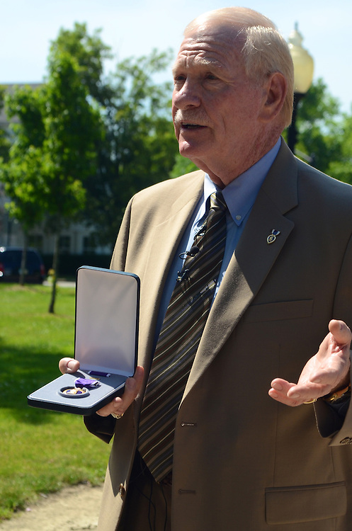 LAURA FONG TORCHIA - Sergeant David Hack, Retired Vietnam veteran speaks to the press after recieving a Purple Heart Thursday in Hudson.  The medal - one of 7 medals awarded him by Congressman Steve LaTourete came 43 years after he was injured in combat.