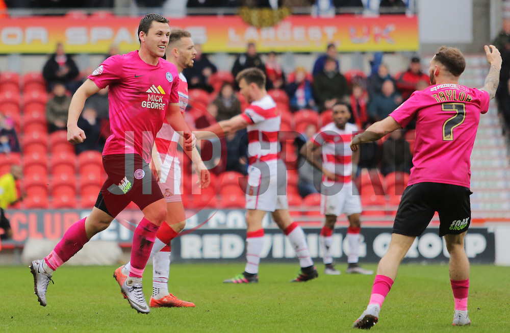 Aaron Williams of Peterborough United (left) celebrates scoring his goal - Mandatory byline: Joe Dent/JMP - 19/03/2016 - FOOTBALL - The Keepmoat Stadium - Doncaster, England - Doncaster Rovers v Peterborough United - Sky Bet League One