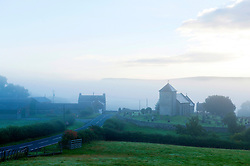 © Licensed to London News Pictures. 20/09/2015. LLanddewi'r Cwm, Powys, Wales, UK. The Welsh hamlet of LLanddewi'r Cwm is surrounded by  fog this morning. Photo credit: Graham M. Lawrence/LNP
