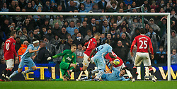 MANCHESTER, ENGLAND - Sunday, January 8, 2012: Manchester City's Joleon Lescott is brought down in the Manchester United area during the FA Cup 3rd Round match at the City of Manchester Stadium. (Pic by David Rawcliffe/Propaganda)