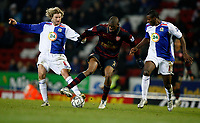 Photo: Paul Greenwood/Sportsbeat Images.<br />Blackburn Rovers v Arsenal. Carling Cup, Quarter Final. 18/12/2007.<br />Arsenal's Abou Diaby, (C) is tackled by Blackburn's Robbie Savage