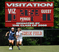 26 MAY 2012 -- TOWN & COUNTRY, Mo. -- Visitation Academy soccer player Mackenzie Krus (2) battles St. Dominic High School player Bri Ebenroth (4) during the MSHSAA Class 2 girls' soccer quarterfinals at Visitation Saturday, May 26, 2012. St. Dominic topped the Vivettes 8-1 to advance to Friday's semifinals against Helias Catholic High School at Blue Springs South High School. Photo © copyright 2012 Sid Hastings.