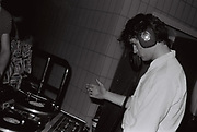 Neil Pearce DJing at a pool party, West London, UK, 1984