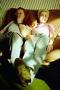 Lesley and Charlotte sat on a sofa, High Wycombe, UK, 1980s.