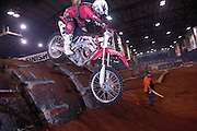 Honda racer going down back side of tire obstacle at the 2007 Maxxis AMA Endurocross at the Lazy E Arena in Guthrie, Oklahoma.  Event was won by David Knight #101 on KTM