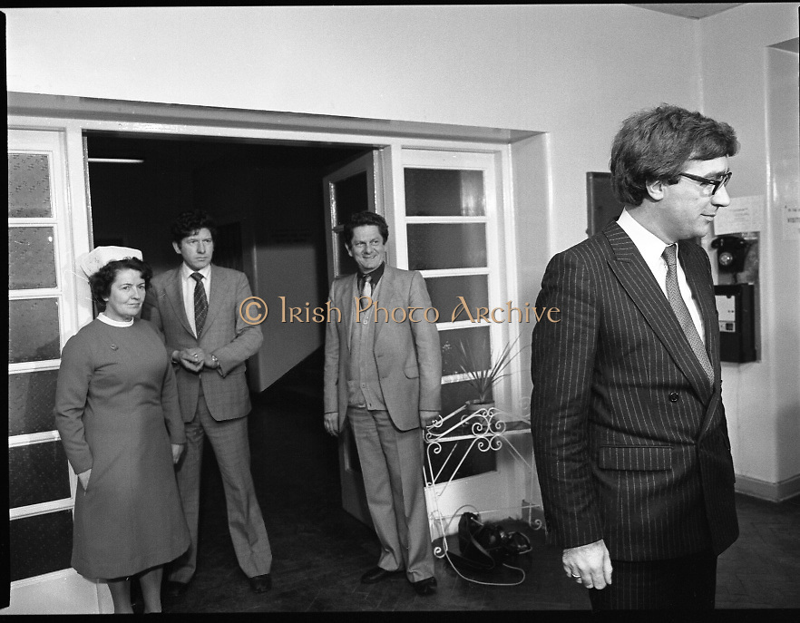 Jim Mitchell Visits Dr Jim Donovan.  (P8)..1982..07.01.1982..01.07.1982..7th January 1982..Following the attempted murder of Dr Jim Donovan, Senior Forensic Scientist at the Garda Technical Bureau, Jim Mitchell, the Minister for Justice,visited St James's Hospital for an update on his condition. It is suspected that the Dublin criminal, Martin Cahill,was the organiser of the bombing which severely injured Dr Donovan...Image shows Jim Mitchell, Minister for Justice being greeted by hospital personnel on his arrival at St James's Hospital for his visit to Dr Donovan.