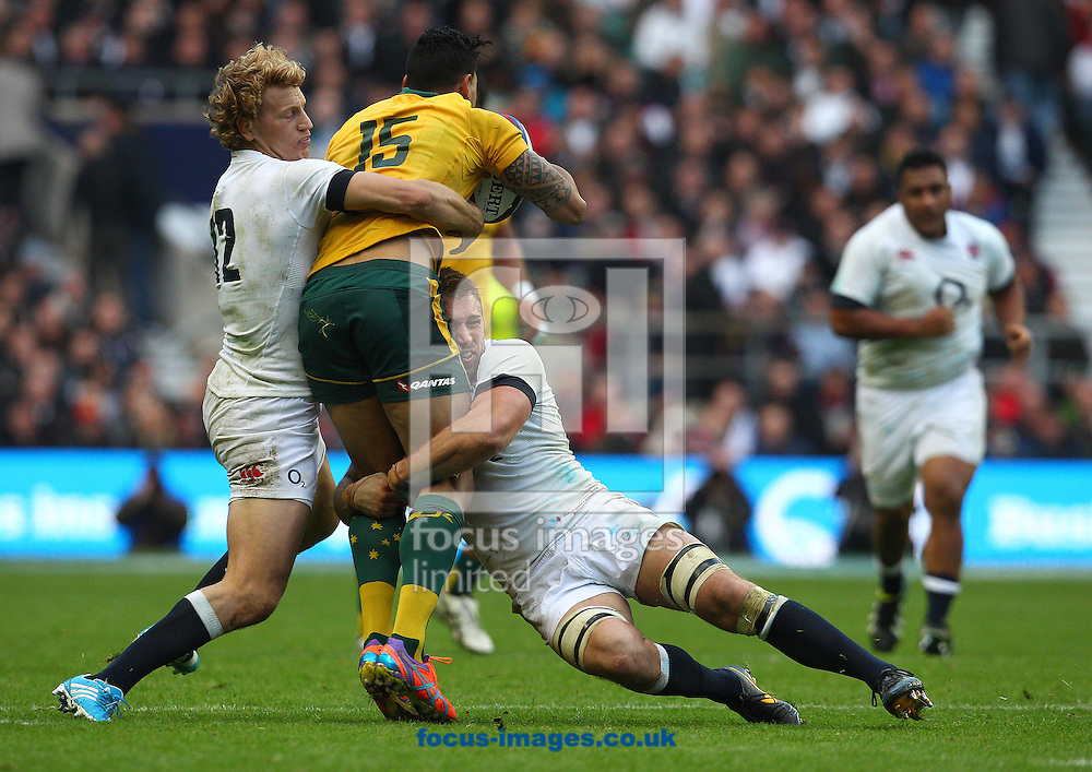 Picture by Paul Terry/Focus Images Ltd +44 7545 642257<br /> 02/11/2013<br /> Chris Robshaw ( 2nd R ) and Billy Twelvetrees of England tackle Israel Folau of Australia during the QBE Internationals  match at Twickenham Stadium, Twickenham.