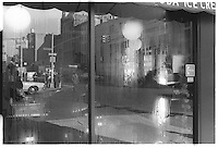 Reflection in a restaurant window. Street photography. 1980